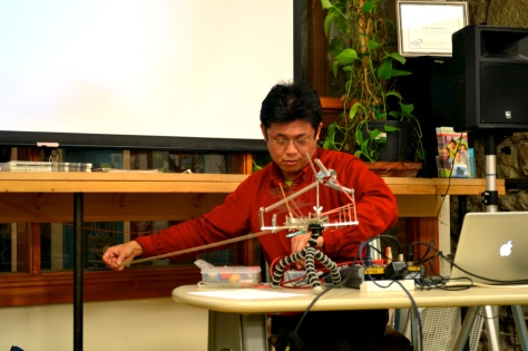 Adachi  performs on a self-made instrument.