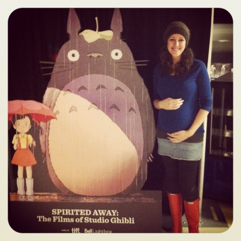 My wife and Totoro-fan-to-be posing with Totoro cutout.